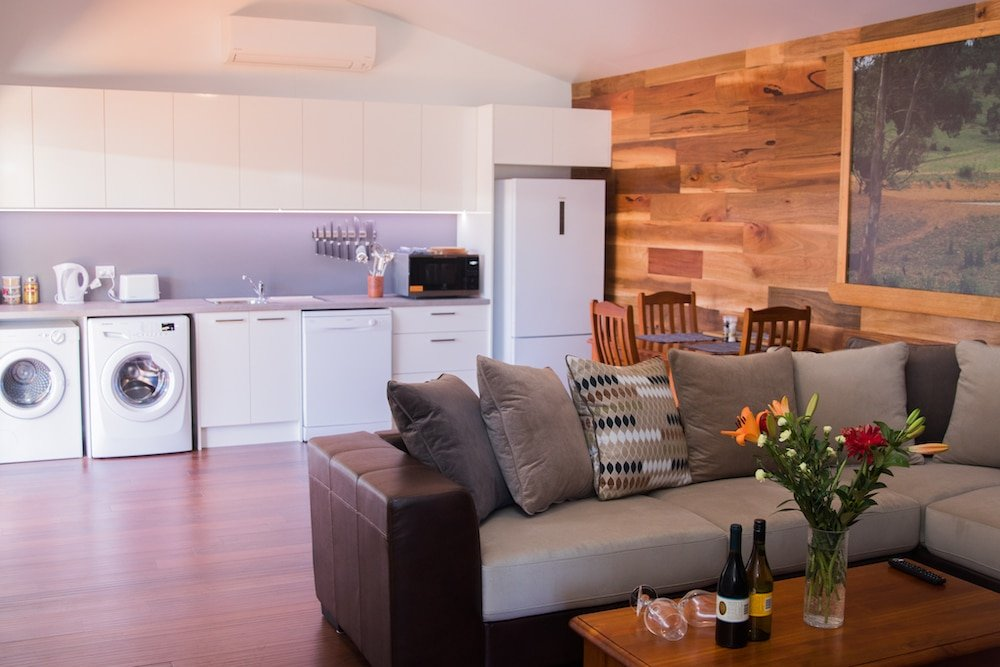 mudgee apartment kitchenette with laundry area and living area